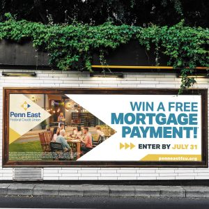 billboard design for Penn East Credit Union brand, advertising free mortgage payment raffle